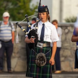 Band member playing pipes